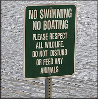 Sign posted at the lake